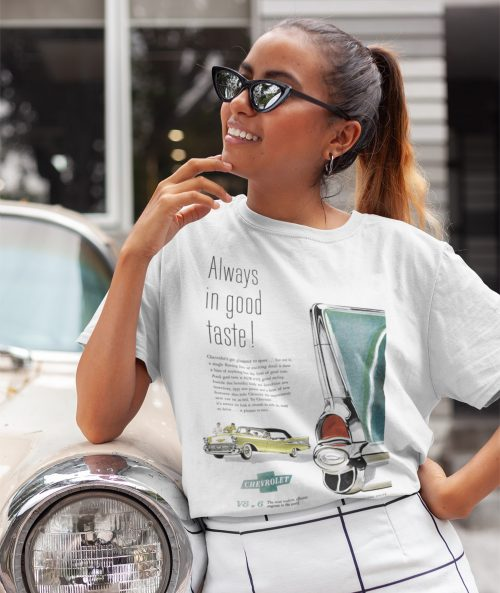 Young lady leaning on Cadillac wearing 1957 Chevy t shirt