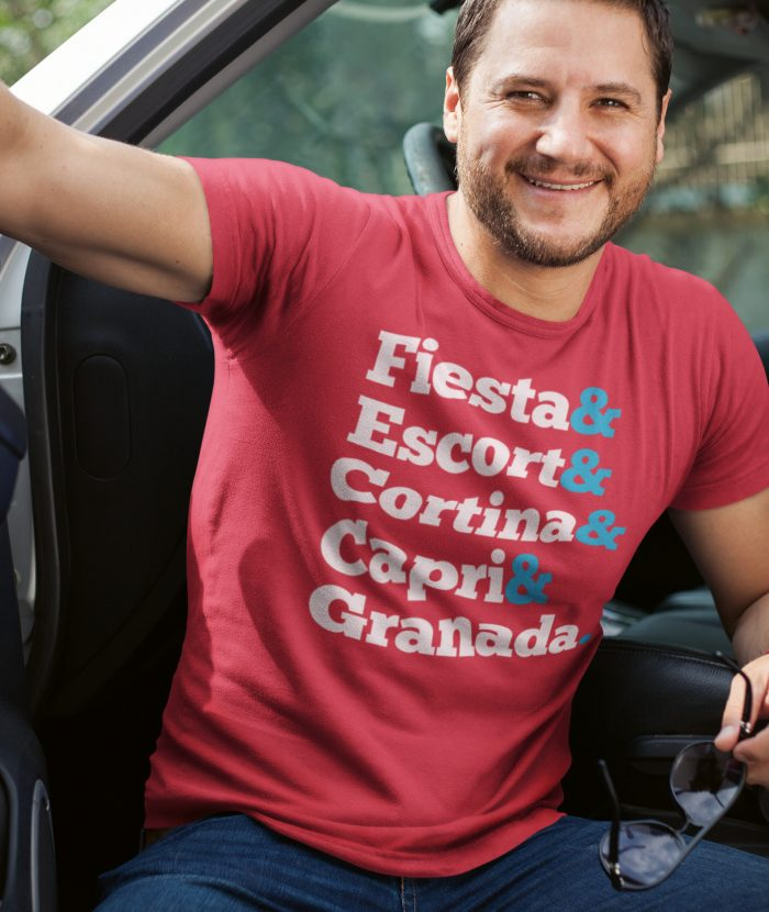 Man in car wearing Red Ford Names T Shirt