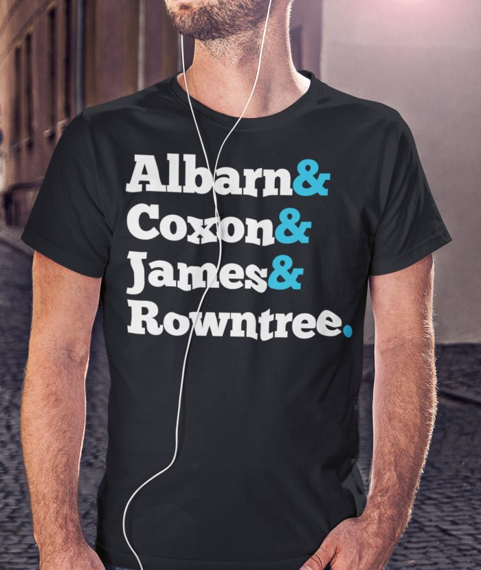 Man with Earphones wearing Black Blur T Shirt