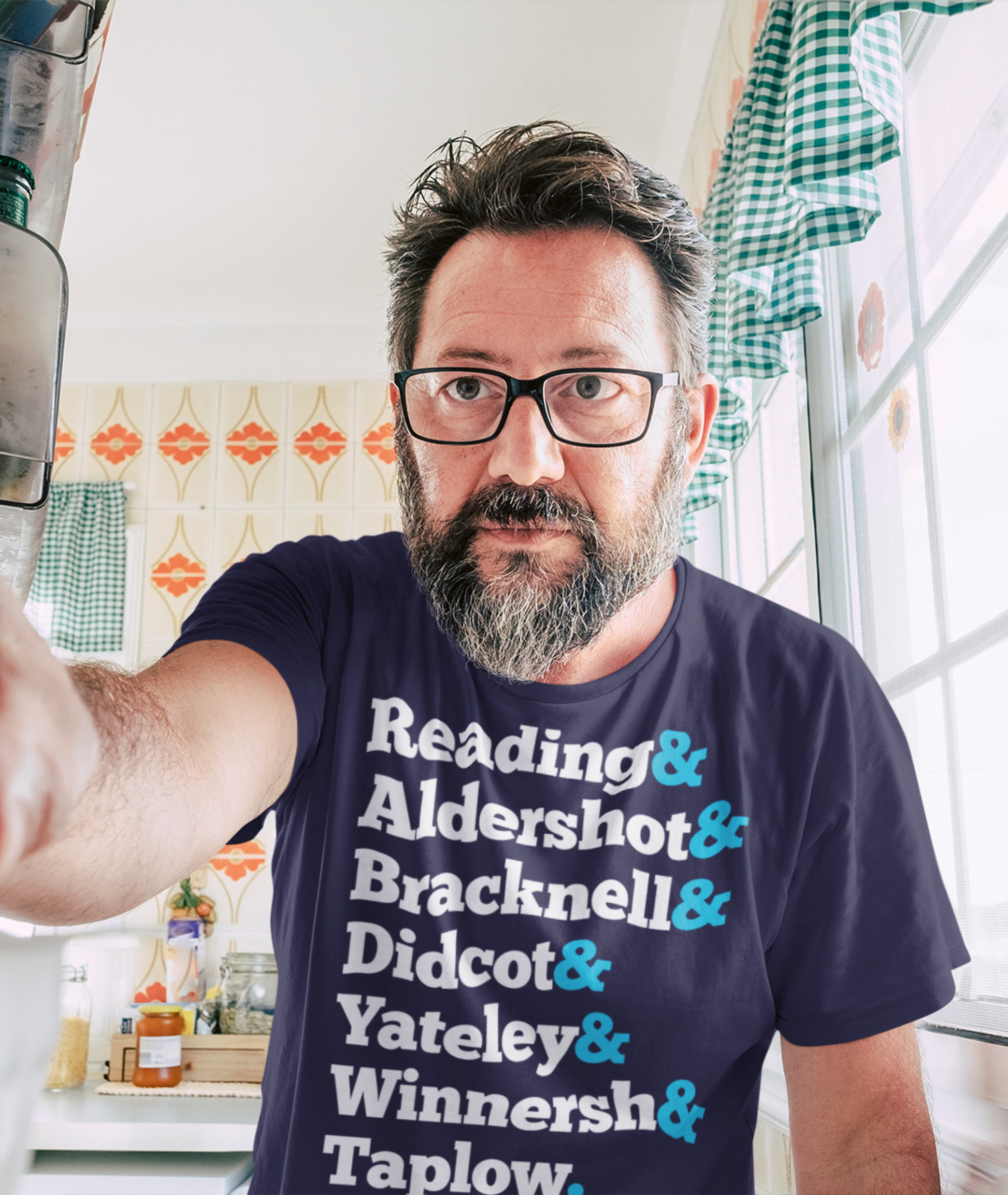 Man with Beard Wearing The OffIce Navy Ampersand T Shirt