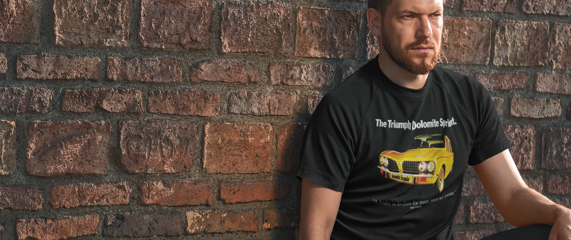 Man leaning on wall wearing Triumph Dolomite Sprint t shirt