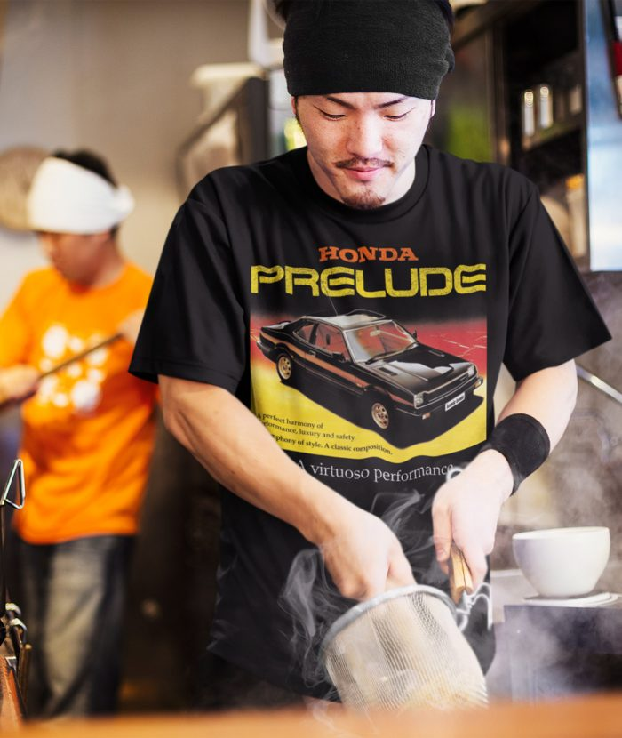 Oriental ched cooking wearing a honda prelude t-shirt