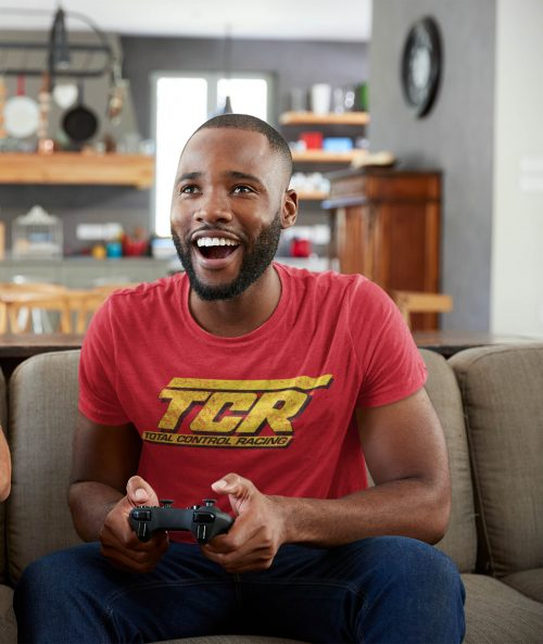 man in red tcr t shirt gaming