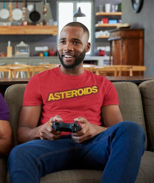 man wearing asteroids retro gaming t-shirt