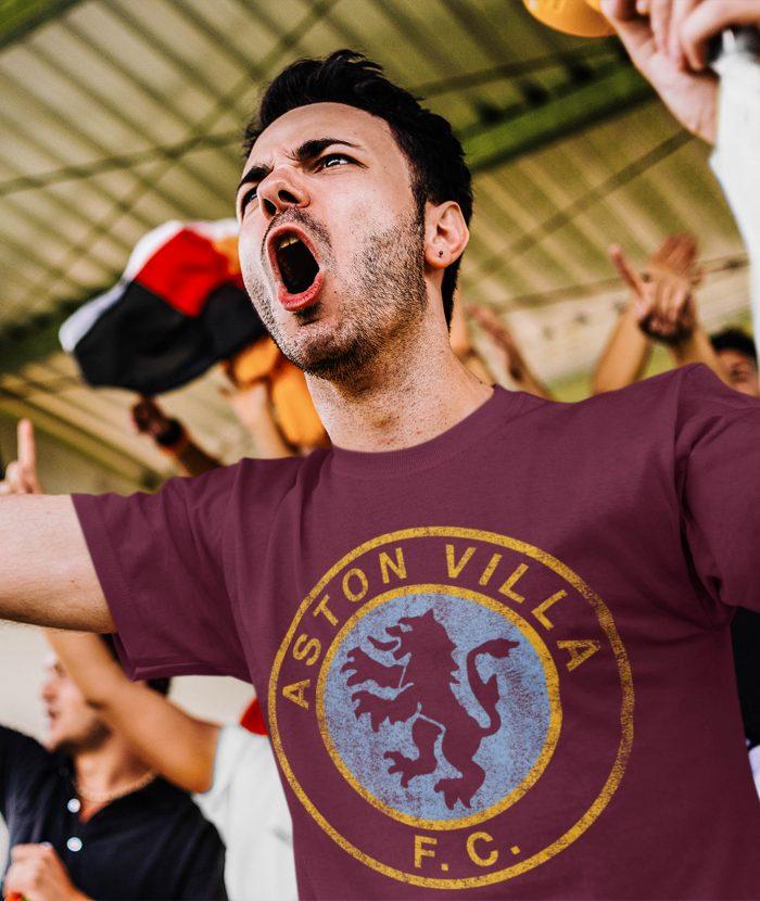 Foootbal fan in stands wearing retro Aston Villa t shirt