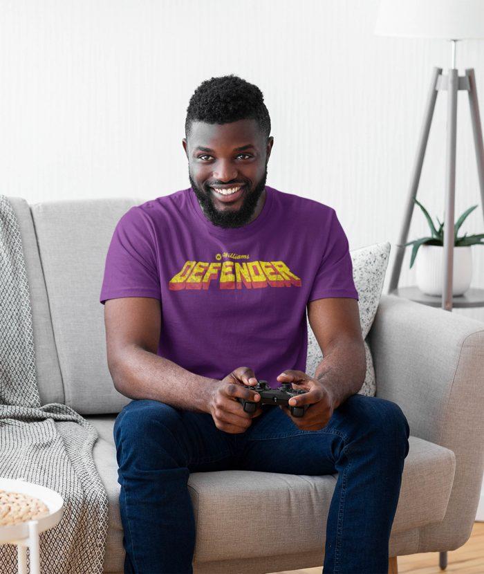 man wearing purple defender t shirt