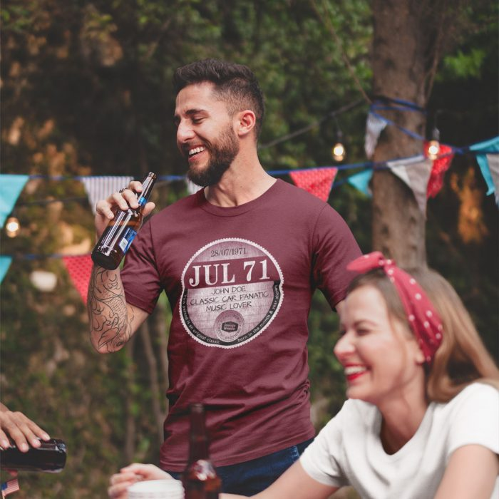 Man with beer wearing maroon July 71 large graphic tax disc t shirt