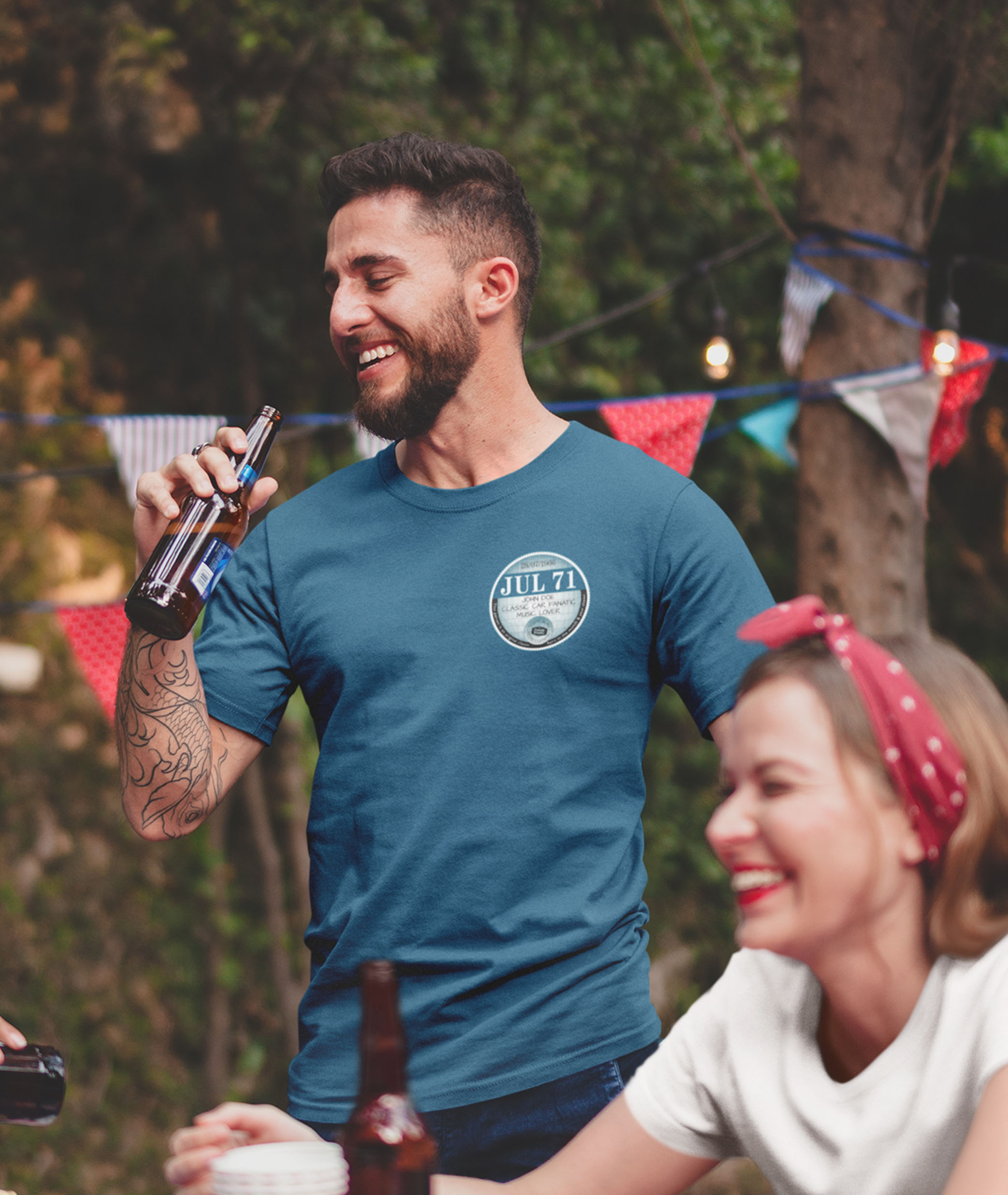 Man with beer wearing indigo July 71 left chest tax disc t shirt