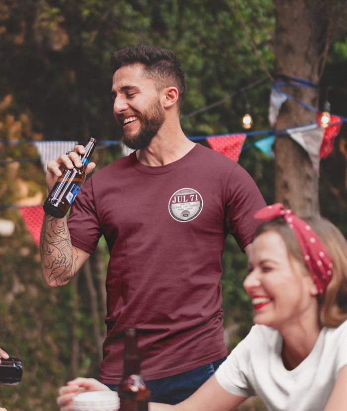 Man with beer wearing maroon July 71 left chest tax disc t shirt