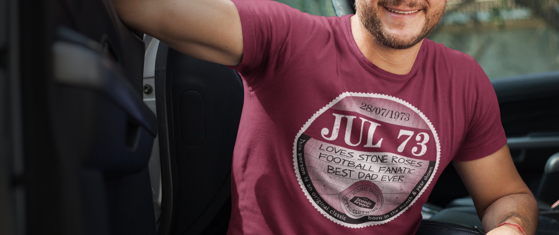Man in car wearing large maroon father's day car tax t-shirt design